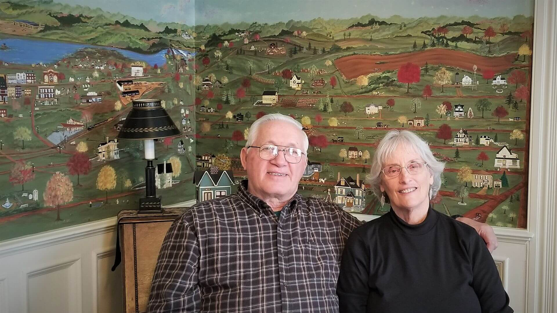 Ron and Margaret Delaney in front of the mural of Janesville