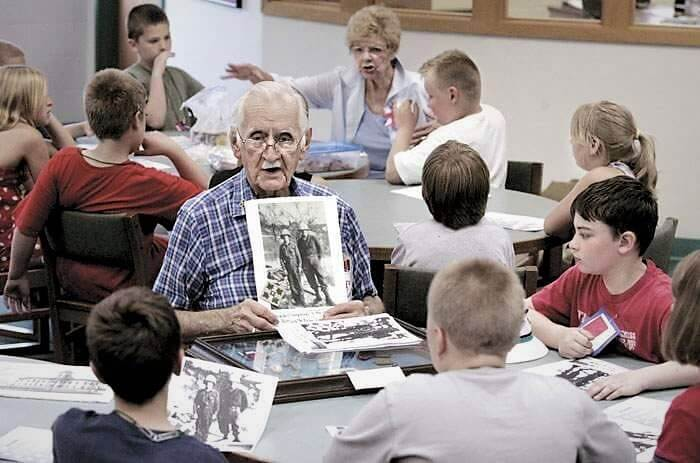 Frank Douglas teaching school children about WWII, photo by Christopher Rabuck