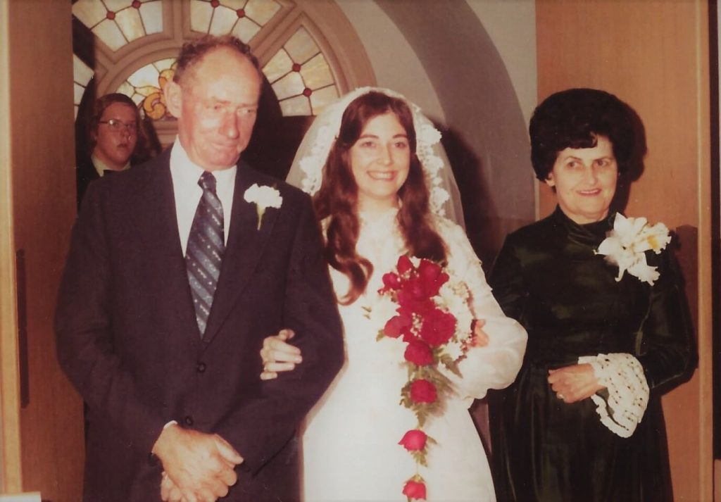 Milly on wedding day 1973, her dad, John and mom, Kay