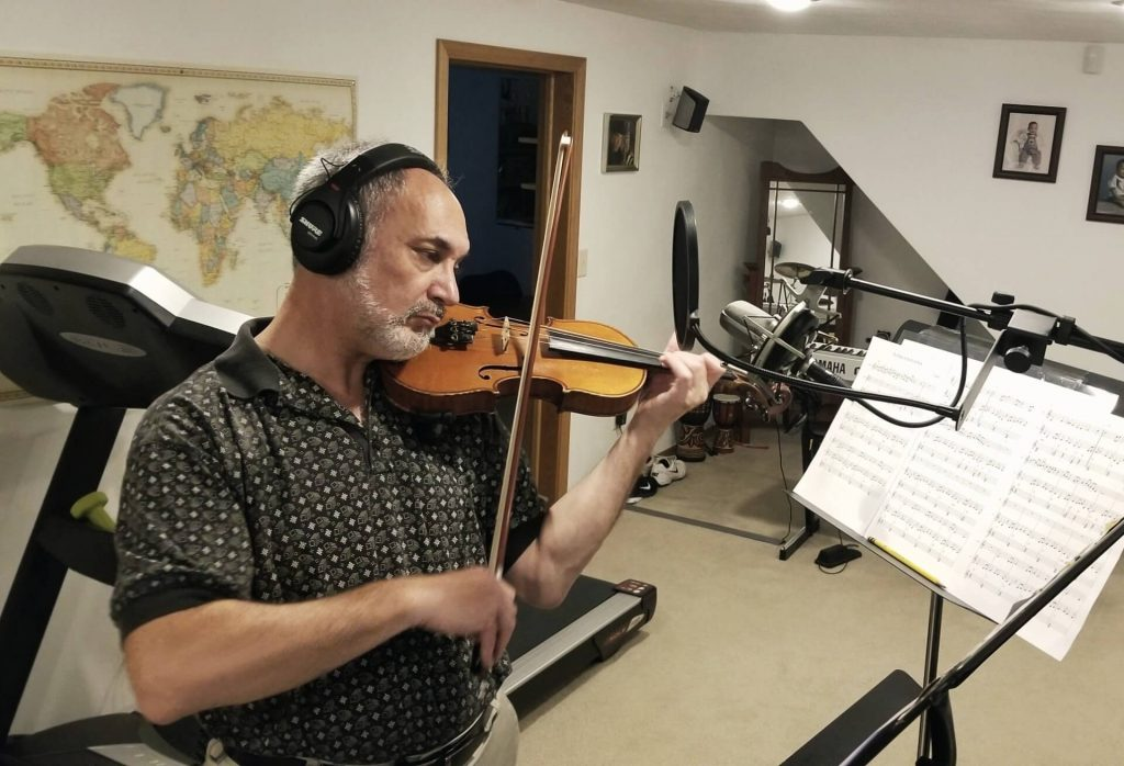Mitch Kopnick records violin on the song Banks of the River Rock