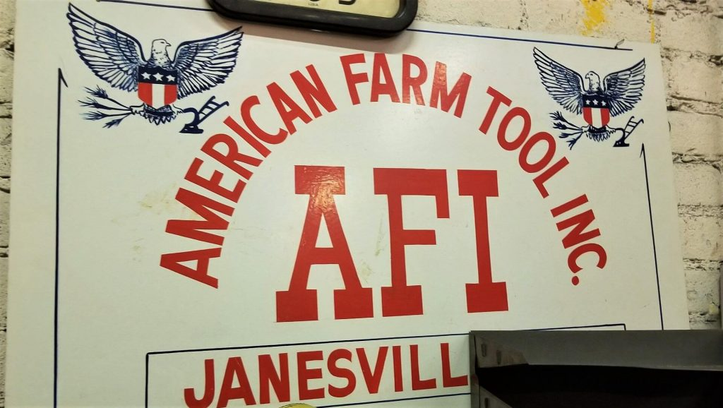 An American Farm Tool sign hangs inside Enginaire