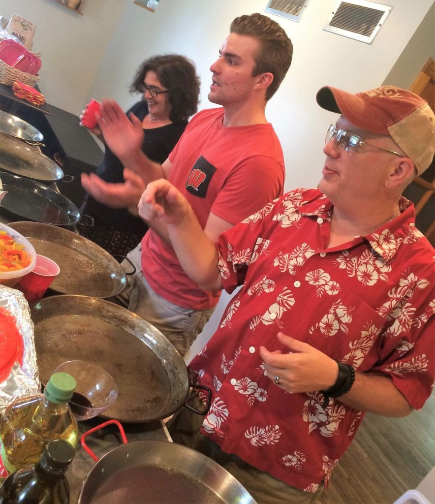 Outside of work, Tim enjoys cooking for 150 people at an annual family Paella Festival