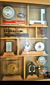 A shadowbox made by Bill's son displaying Hyzer's many inventions.